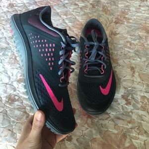Grey and pink Nike running shoes